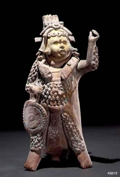 Maya Warrior Description: Maya. Jaina. whistle. height 25.4 cm. Warrior wearing cotton armor. He carries a battle standard