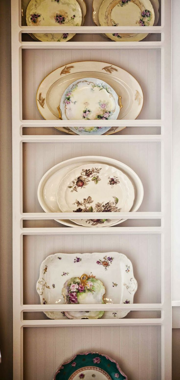 Built-in plate racks. No tutorial. Go here to look at them empty. http://www.cedarhillfarmhouse.com/2013/08/my-interior-paint-selections-new-house.html