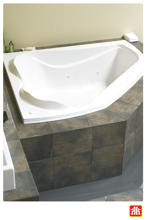 Turn your bathroom into a spa oasis with this corner whirlpool tub!