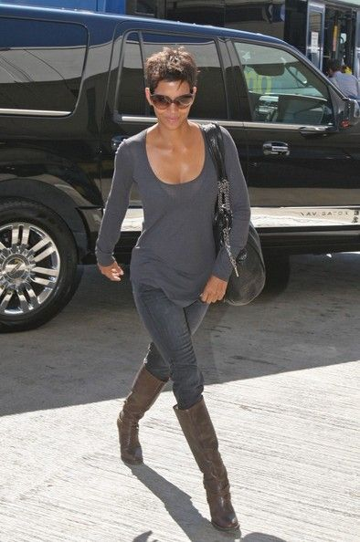 The always lovely Halle Berry arrives at LAX to catch a flight.   (September 27, 2010 - Source: Bauer Griffin) see more angles »     Newest Full List            Prev  159 of 218   Next     Halle Berry Knee High Boots  Brown knee-high boots were the perfect footwear for Halle Berry's travels.   Halle Berry Loose Blouse  Halle has a plethora of soft gray blouses like this one.