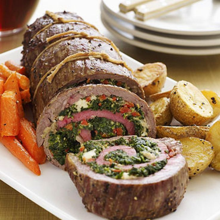 Stuffed Flank Steak (6 servings) - spinach, blue cheese, red peppers.  FamilyCircle.com