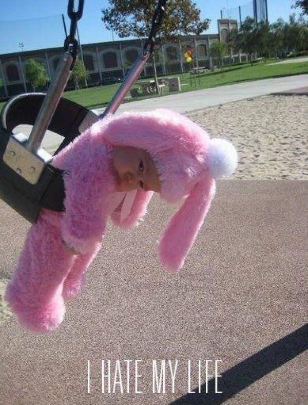 Sadness, stuffed in a bunny suit, stuffed in a swing...