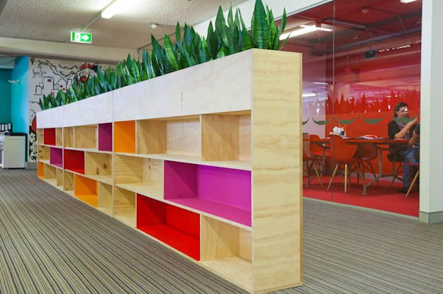 Wood + colour + office space.