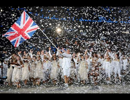 Great Britain's Chris Hoy carries the flag during the opening ceremony at the 2012 Summer Olympics, during the wee hours of Saturday, July 28, 2012, in London. (Cameron Spencer/Pool/AP Photo)