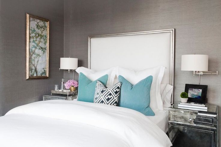 Love the gray grasscloth wallpaper and the framed headboard! So elegant. By Carlyle Designs.