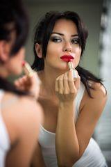 Applying lip stick for transvestite