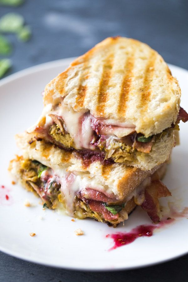 Loaded Turkey Panini for all your Thanksgiving leftovers! Piled high with turkey, cheese, cranberries, fried sage, goat cheese, pear slices - and anything else your heart desires.