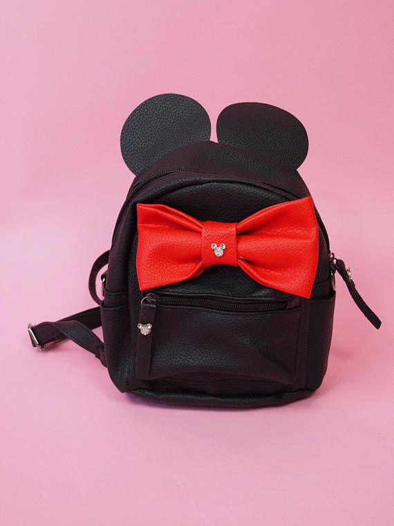 Disney Minnie Mouse Black Faux Leather with a Red Bow Mini Backpack with convertible straps to side purse perfect for Disney Parks The only backpack that has permanent Hidden Mickey Rhinestones! Straps are faux leather with clips that can change from backpack to over the shoulder