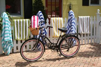 Hit the beach with our classic Regatta white and stripe outdoor towels. Shop all colors now.