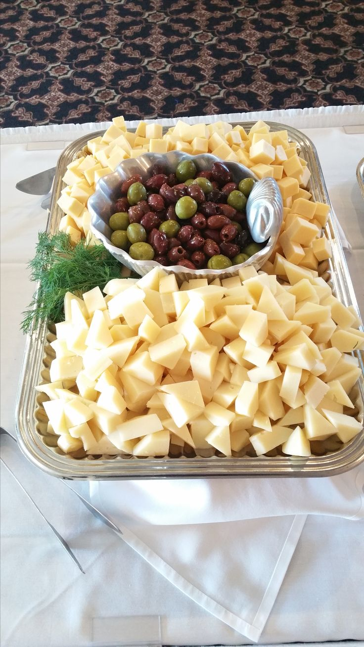 The cheese and olive tray is one of our signature