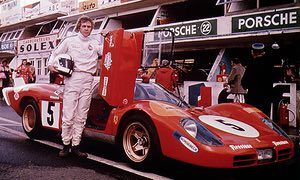 Steve McQueen, who played a racing driver called Michael Delaney in the 1971 film Le Mans, poses in the pit lane.