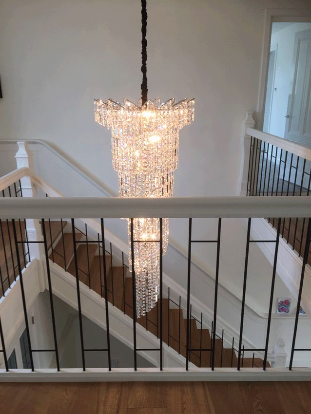Beautiful living room pictures ideas with cascading cristal chandelier