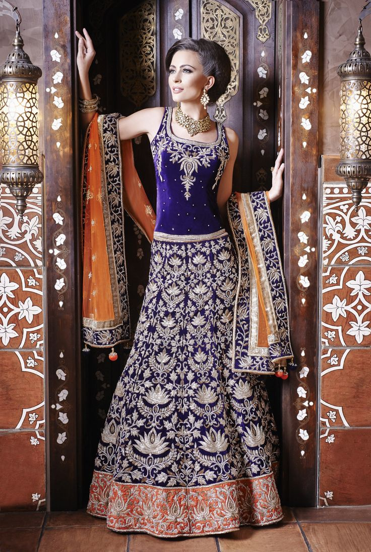 New Reception Dresses Purple velvet lengha ideal for a wedding reception clustered in Swarovski diamante embroidery with a contrast orange soft net dupatta