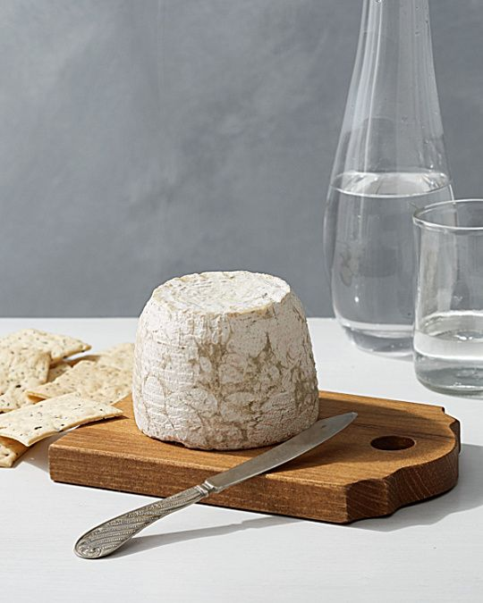 Made in Europe from reclaimed wood and paired with a vintage silver-plated cheese knife, this rustic cheese board makes a wonderful gift for anyone who likes to entertain.