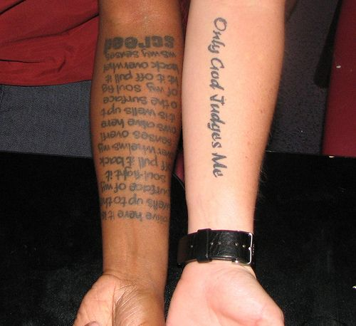 Forearm script tattoo designs for men