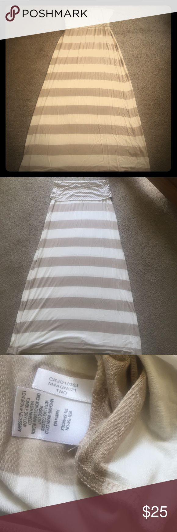 Versatile tube dress/fold it down for a skirt  NWOT never worn Calvin Klein beauty skirt or tube dress. Forget this cold raining ☔️ time and get ready for the sunshine ☀️ soon! No damage, no rips or tears. Size is a medium but would fit a large gorgeous! It's brand new just no tags.  Calvin Klein Dresses Maxi
