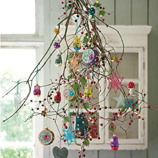 like an upside down christmas tree this darling idea adds whimsical holiday fun using one or two branches and a handful of ornaments