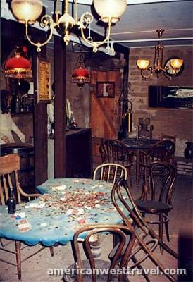 he table in the foreground hosted the longest poker game in western history - Bird Cage Theater, Tombstone, Arizona.