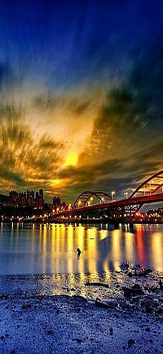 New North City five shares of water Shalian dawn sunrise #by a0931342819 李 萬豐 #sunset sun pier sky clouds yellow orange water reflection city nature amazing beach bridge