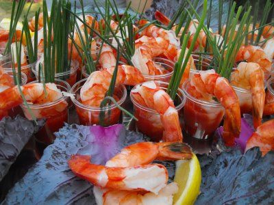 Check it out: Cocktail Shrimp Shooters.  Good red sauce recipe along with this.
