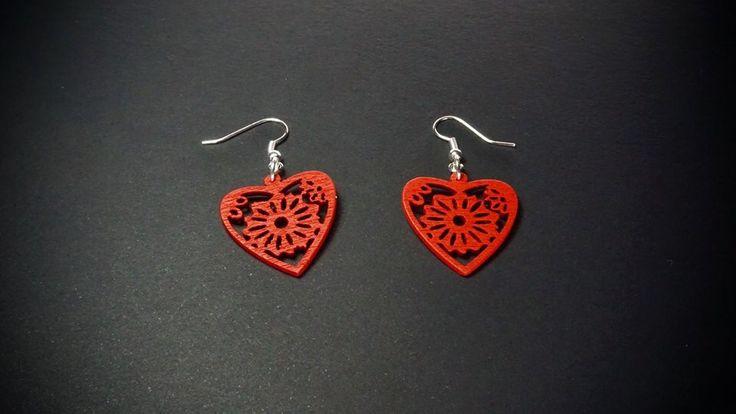 Earrings by Skitsanos. Laser cut wood.