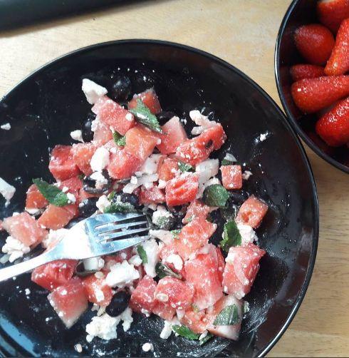 Watermelon Feta Salad - Watermelon, black olives, red onion (steeped in cider vinegar, salt and sugar), feta and fresh mint.