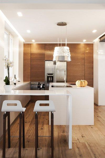 Small kitchen design idea in a sophisticated home, renovated by m12 AD to be in perfect balance with the surrounding environment - located in Italy
