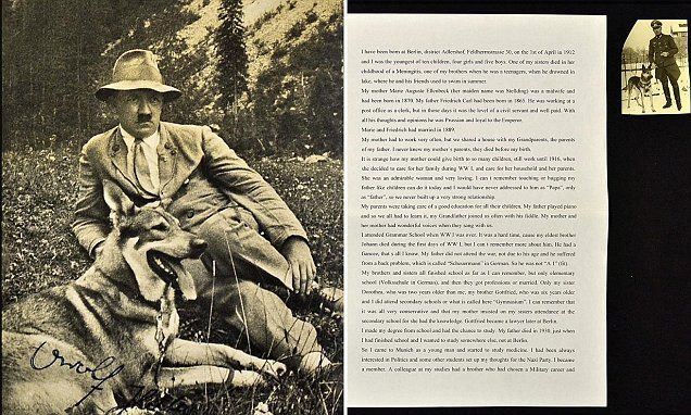 Signed postcard of Hitler lying down with his dog Blondi for £5,000