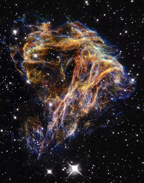 Resembling the puffs of smoke and sparks from a summer fireworks display in this image from NASA's Hubble Space Telescope, these delicate filaments are actually sheets of debris from a stellar explosion in a neighboring galaxy. Hubble's target was a supernova remnant within the Large Magellanic Cloud (LMC), a nearby, small companion galaxy to the Milky Way visible from the southern hemisphere.