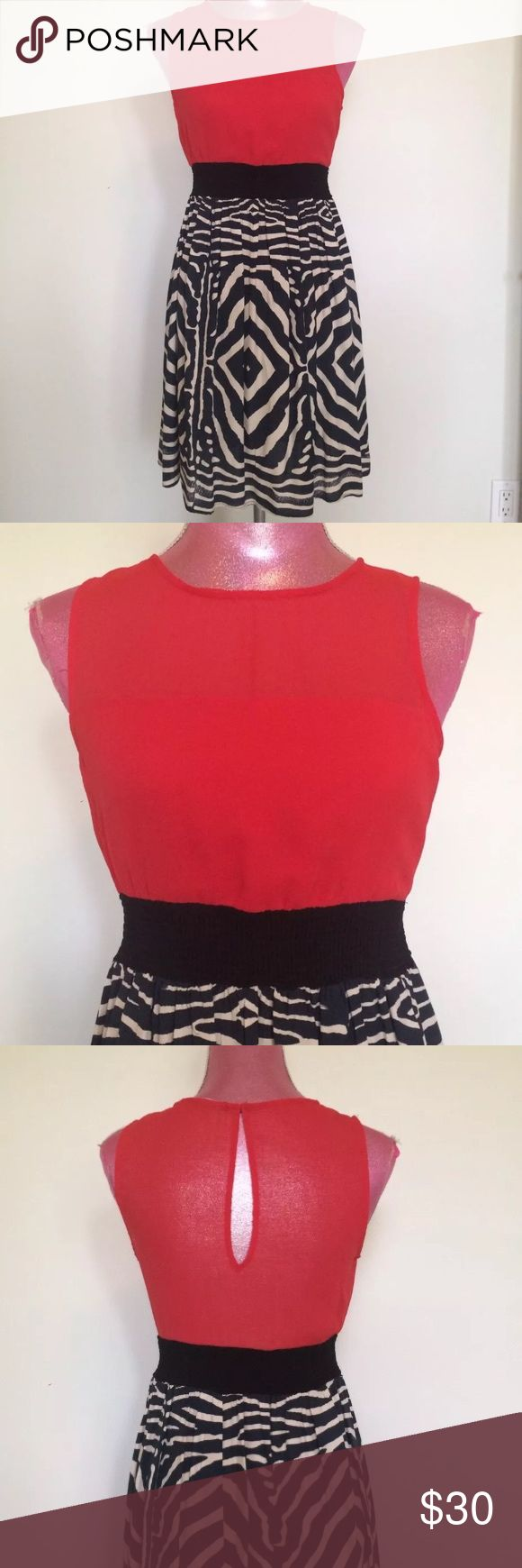 """Zara Dress Size medium - approx. measurements laying flat- 16"""" W across chest - 34 1/2"""" L shoulder to hemline  Material tag removed - Top portion poly/Crepe? Skirting rayon? - Red, black and Beige - Smocked elastic stretch banded waist - keyhole back with single button closure  Excellent pre-owned condition with no stains, tears or odors Zara Dresses"""