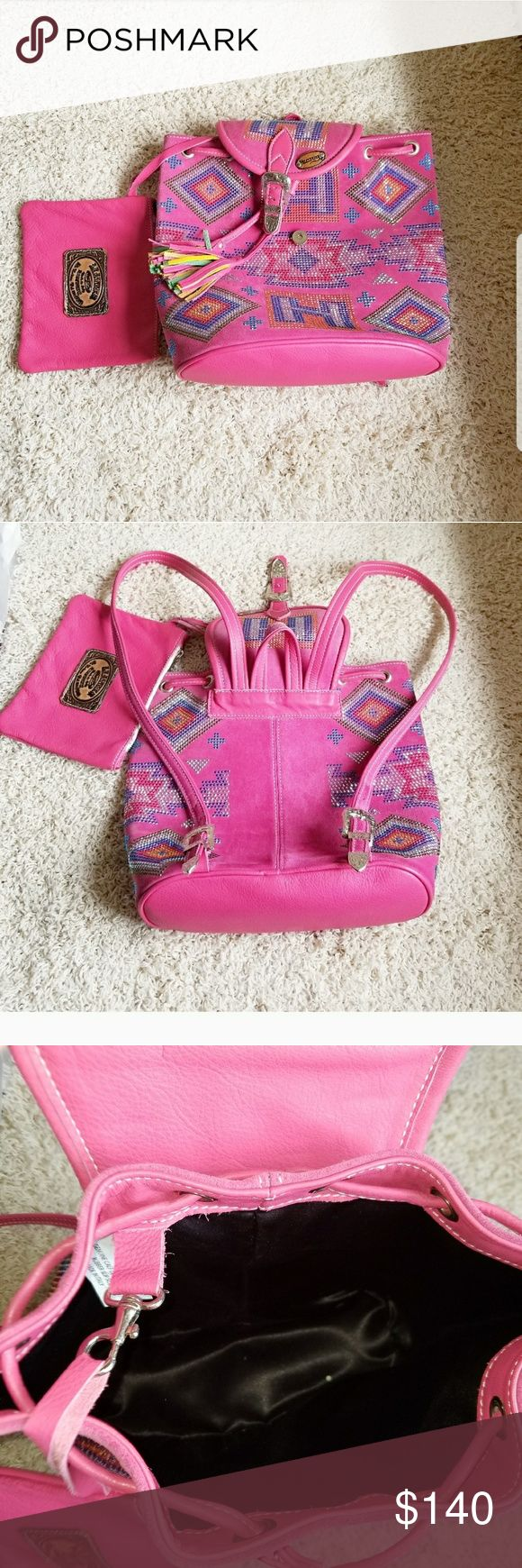 Leather Hector Riccione swarovski backpack Pink leather Hector Riccione backpack studded with swarovski crystals. It has a detachable clutch. Perfect condition. Got it from a boutique in Miami but never used it. Hector Riccione Bags Backpacks