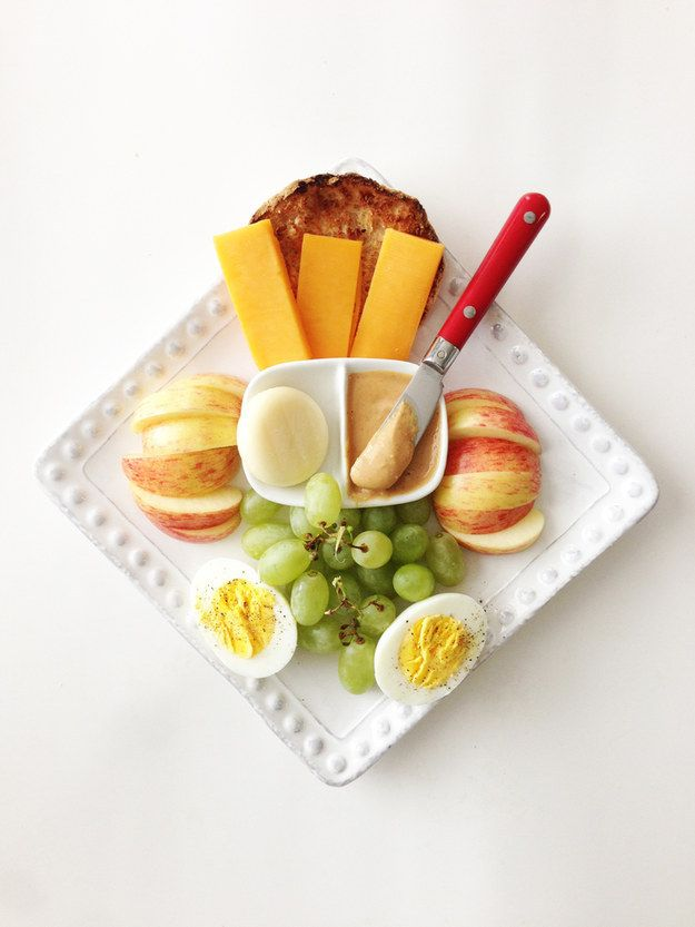 DIY Starbucks Protein Box  - 1/2 Light '100 Calorie' Whole Wheat English Muffin, Toasted - 1/2 Oz. 2% Sharp Cheddar, Sliced - 1 Mini Babybel Light Original Cheese Wedge - 1 Tbsp. PB2 - Peanut Butter 2, Prepared - 1 Small Apple (I used Gala.) - 3/4 C. Grapes (Green or Red) - 1 Whole Large Egg, Hardboiled  Calories: 361 Protein: 24.4g Carb: 37g Fiber:  5.3g Fat: 14.7g