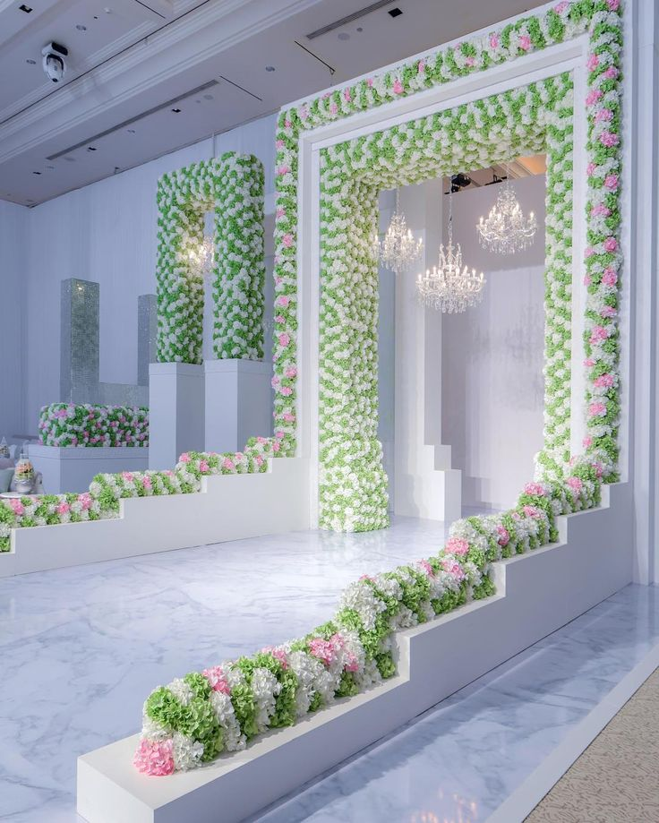 Imagine getting married beneath this incredible #floralarch! | Photography By: John Labbe. | WedLuxe Magazine | #luxury #wedding #luxurywedding #weddinginspiration #decor #design #weddingdecor #eventdesign #floral #flower #floralarrangement