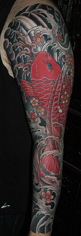 red koi with waves and cherry blossoms japanese sleeve tattoo