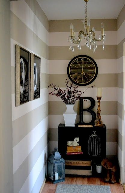 Beige and white horizontally striped hallway inspiration with black and white accents