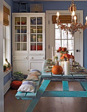 I cut this picture out of a Country Living magazine years ago, and it is still one of my faves. I definitely plan on doing this -- a picnic table (turquoise, no less!) in my informal dining area.