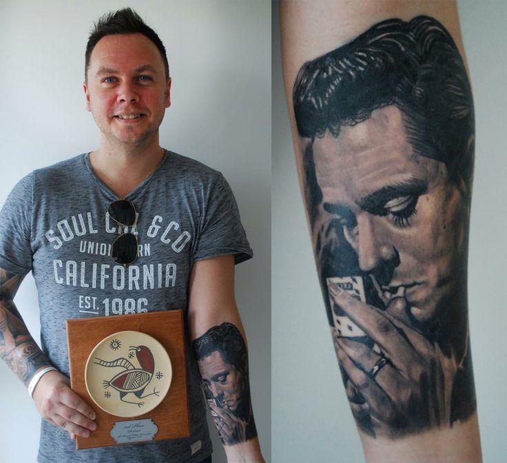 Johnny Cash portrait tattoo. Black and grey