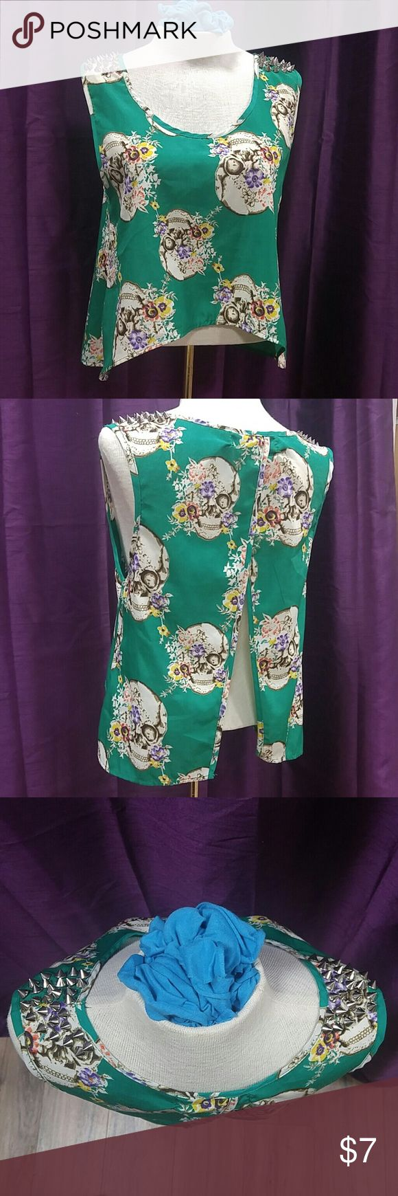 Reverse Small Skulls & Flowers Smock Top w Studs Kelly green background with Dia los Muertos print with skulls with flowers and silver toned spikes on the shoulders (one is missing near neckline) but i dont think anyone will notice or care because this top will be such a conversation piece. Its feminine and morbid and pretty and just wonderful. Name was written in marker in the inside tag. reverse Tops