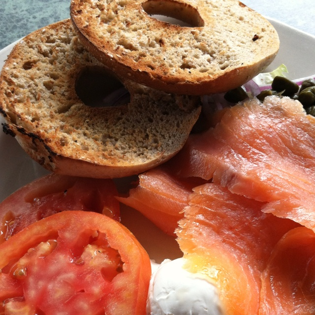 Lots of Lox! Enjoying brunch outside a DC neighborhood eatery: Salmon, cream cheese, tomato, whole wheat bagel (close to a NYC bagel) , and runaway capers.