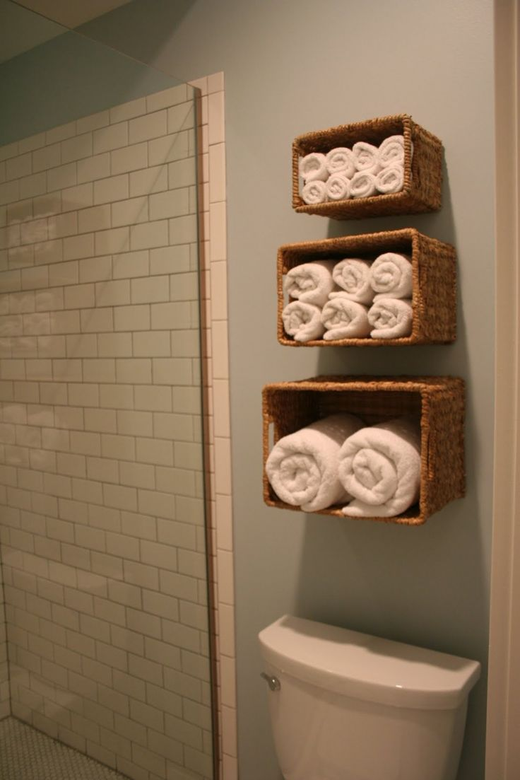 towels in mounted baskets - LOVE this idea for our guest bathroom!! And, it would keep guests out of my messy closet too!!