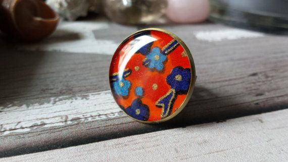 Round statement  ring, japanese kimono style, with blue and light blue flowers in orange background