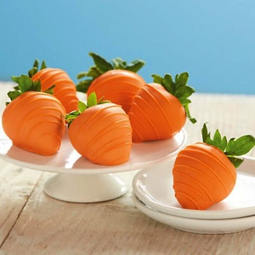 This is such a cute idea for Easter! Dip strawberries in white chocolate that's tinted with orange food coloring for a carrot-inspired treat!
