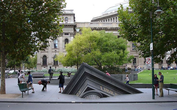 Most creative, beautiful modern statues and sculptures - 16 Sinking Building Outside State Library...Melbourne, Australia.