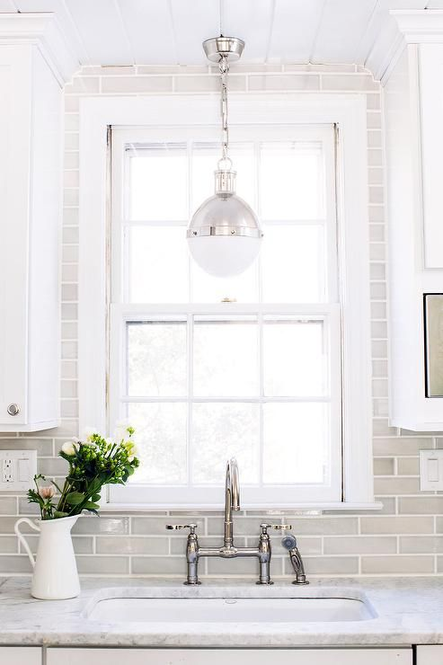 white and gray kitchen features white shaker cabinets paired with white marble countertops and thin gray backsplash tiles this one is the color template