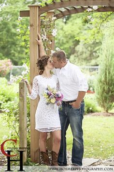 Dustin in dark blue jeans, white shirt no flower. Stephanie white dress, brown ribbon to match boots, yellow sunflowers with navy? and cream tied with burlap with lace in the bouquet. Men in jeans and Brown shirts, Girls in Creamy white with jean jackets and boots?