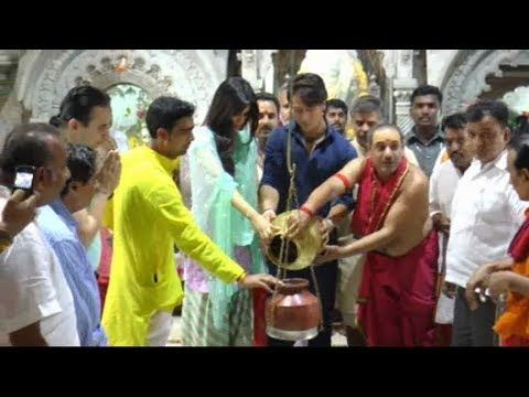 Tiger Shroff and Kriti Sanon spotted at Babulnath Temple seeking blessings.