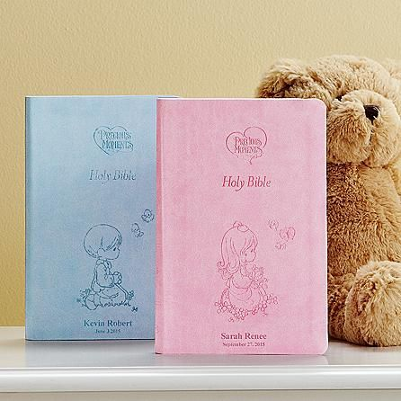 """Contains the full text of the easy to read International Childrens Bible. Features 20 pages of colorful illustrations, a presentation section to record family information and a childrens dictionary to explain difficult words and phrases. We personalize the soft, leather flex cover with any message on 2 lines, up to 18 characters per line. Available in your choice of pastel pink or blue. 1,152 pages. Bibles measure 8 3/4""""H x 5 3/4""""W x 1 1/4""""D."""
