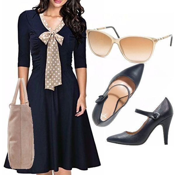 """Questo look """"pulito"""" e sobrio è per donne che amano particolarmente lo stile bon ton, uno stile adatto a chi vuole valorizzarsi con classe ed eleganza , insomma per un tipo di donna raffinata e aggraziata, vediamolo meglio: Vestito blu navy avvitato, al ginocchio, scollo a scialle in contrasto che si lega a fiocco, occhiale da sole, scarpe Mary Jane, shopping bag neutra."""