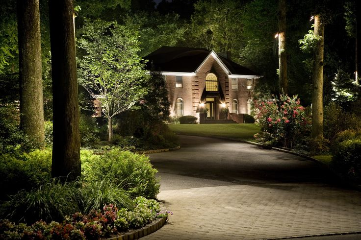 Fresh Cast Lighting Moon light and uplighting along a driveway with a well lit home in Luxury - Modern landscaping lights Fresh