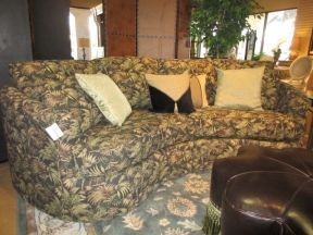 """Item #: 40951 A La-Z-Boy sectional sofa in a tropical, palm print fabric. The shape of this sofa is so attractive. It comes with all four of the decorative pillows shown here as well as two matching print pillows. Measurements are 112"""" wide x 29"""" deep x 30"""" high."""